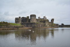 Caerphilly Castle near Cardiff Wales in March 2017. Picture from across the moat of Caerphilly Castle constructed by Gilbert de Clare in the 13th century Stock Image