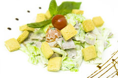 Caesar Salad. With croutons, lettuce, chicken, dressing and a tomato on a top Royalty Free Stock Images