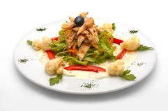 Caesar salad. With lettuce, chicken meat, red pepper, cauliflower, carrot and one black olive Royalty Free Stock Photography