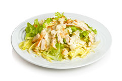 Caesar salad. With chicken and croutons. Isolated on white by clipping path stock photo