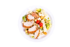 Caesar Salad. With chicken on a plate. On a white background Royalty Free Stock Photo