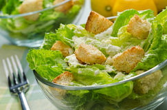 Caesar Salad. A bowl of fresh crisp caesar salad with croutons, parmesan cheese, anchovy, and lemon Stock Images
