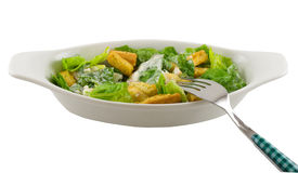 Caesar Salad. Side Caesar salad with fork, isolated on white stock photo