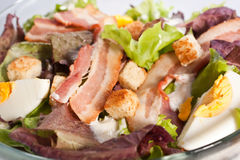 Caesar salad with bacon and eggs Royalty Free Stock Photos