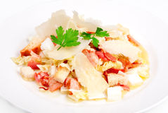 Caesar salad with bacon and parmesan cheese. On the plate Stock Image