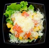 Caesar salad in black bowl, top view Stock Photo