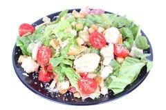Caesar salad on black plate Stock Photo