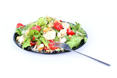 Caesar salad on black plate with fork Royalty Free Stock Photos