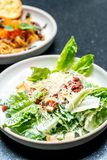 Caesar salad bowl with egg. Healthy food style stock photo