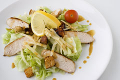 Caesar Salad with chicken. A Caesar Salad with shredded parmesan cheese, croutons, chicken and cherry tomato Royalty Free Stock Images