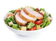 Caesar salad with chicken fillet isolated on white background. With clipping path royalty free stock photography