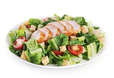 Caesar salad with chicken fillet. Isolated on white background. With clipping path Stock Images
