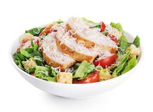 Caesar salad with chicken fillet and parmesan cheese. Isolated on white background. With clipping path Stock Photos