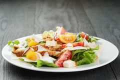 Caesar salad with chiken fillet and different Royalty Free Stock Images