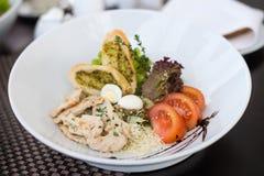 Caesar salad. Closeup of traditional Caesar salad on white plate stock photography