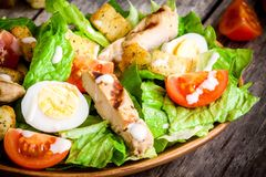 Caesar salad with croutons, cherry tomatoes and grilled chicken Stock Photo