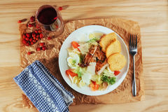 Caesar salad with croutons, quail eggs, cherry tomatoes and gril Royalty Free Stock Photo