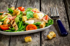 Caesar salad with croutons, quail eggs, cherry tomatoes and grilled chicken Royalty Free Stock Photo
