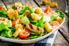 Caesar salad with croutons, quail eggs, cherry tomatoes and grilled chicken Stock Images