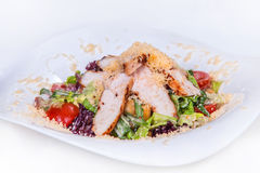 Caesar salad. dish food. Caesar salad with croutons,  lettuce, arugula, cherry tomatoes and grilled chicken.  dish on a white background Stock Photos