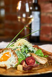 Caesar salad with egg on a beautiful plate jpg Royalty Free Stock Image