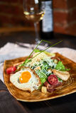 Caesar salad with egg on a beautiful plate jpg Royalty Free Stock Images