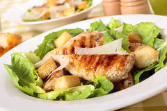 Caesar salad with griddled chicken fillet Stock Image