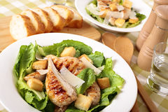 Caesar salad with griddled chicken fillet Stock Images
