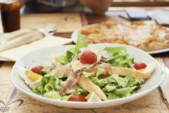 Caesar salad with grilled chicken, ham, eggs and tomatoes Royalty Free Stock Image