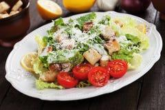 Caesar salad with lemon and cherry tomato Royalty Free Stock Photos