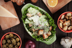 Caesar salad with lettuce, croutons and parmesan cheese Royalty Free Stock Images