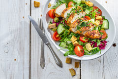 Caesar salad made ��with fresh vegetables Royalty Free Stock Photo