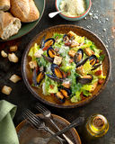 Caesar Salad with Mussels. A delicious caesar salad with mussels, romaine lettuce, bacon, croutons, and parmesan cheese Stock Photography