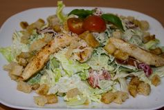 Caesar salad on a plate. Close-up. Background royalty free stock image