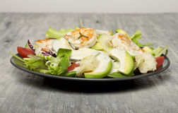 Caesar salad with prawns and avocado. Food & Dishes for Restaurants, Cuisine of the peoples of the world, Healthy Recipes Royalty Free Stock Photos