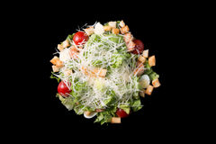 Caesar salad with prawns, cherry tomato and cheese. Isolated Royalty Free Stock Photo