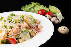 Caesar salad with prawns. Cherry tomato and cheese on white plate Stock Photo