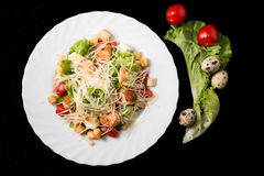 Caesar salad with prawns, cherry tomato and cheese. On white plate Royalty Free Stock Photos