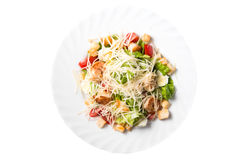 Caesar salad with prawns, cherry tomato and cheese. On white plate, isolated Royalty Free Stock Photos