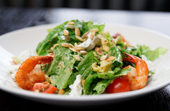 Caesar salad with prawns. And goat cheese stock photography