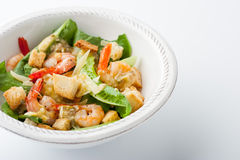 Caesar salad with prawns on the white plate horizontal Stock Photo