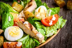 Caesar salad with quail eggs, cherry tomatoes and grilled chicken Royalty Free Stock Image