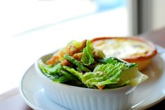 Caesar salad and quiche. On white plate Royalty Free Stock Image
