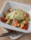 Caesar salad with roasted prawns in a plate Royalty Free Stock Photos