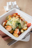 Caesar salad with roasted prawns in a plate Royalty Free Stock Photography