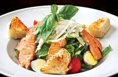 Caesar salad with salmon Royalty Free Stock Image