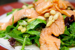Caesar salad with salmon and pine nuts Stock Photo