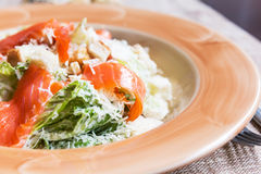 Caesar salad with salmon. On a table royalty free stock image