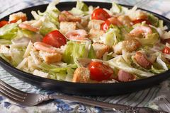 Caesar salad with seafood close-up on a plate. Horizontal Royalty Free Stock Image
