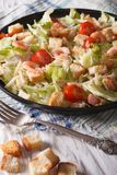 Caesar salad with seafood close-up on a plate. Vertical Royalty Free Stock Photo